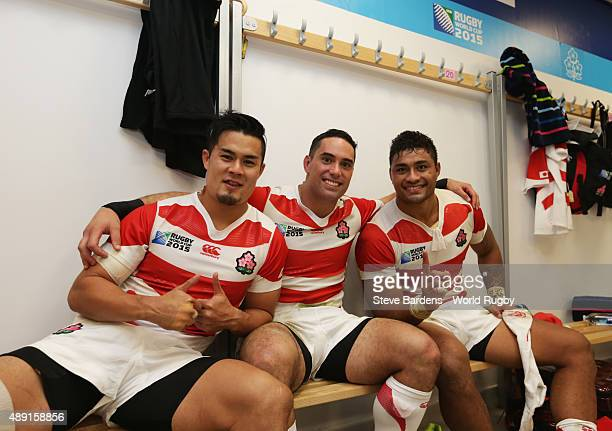 Yu Tamura Karne Hesketh and Amanaki Mafi of Japan celebrate in the dressing room following their surprise victory in the 2015 Rugby World Cup Pool B...