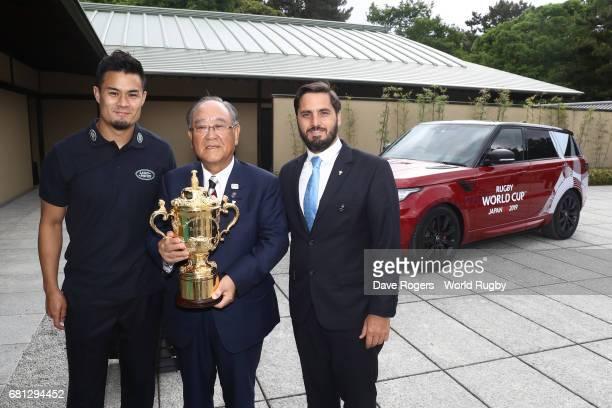 Yu Tamura of Japan Fujio Mitarai Chairman of the RWC 2019 Organising Committee and Agustin Pichot ViceChairman of World Rugby pose with The William...