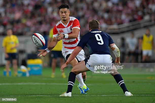 Yu Tamura of Japan passes the ball during the international friendly match between Japan v Scotland at Ajinomoto Stadium on June 25 2016 in Tokyo...
