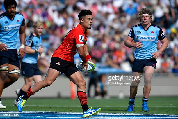 Yu Tamura of Sunwolves passes the ball during the round 15 Super Rugby match between the Sunwolves and the Waratahs at Prince Chichibu Stadium on...