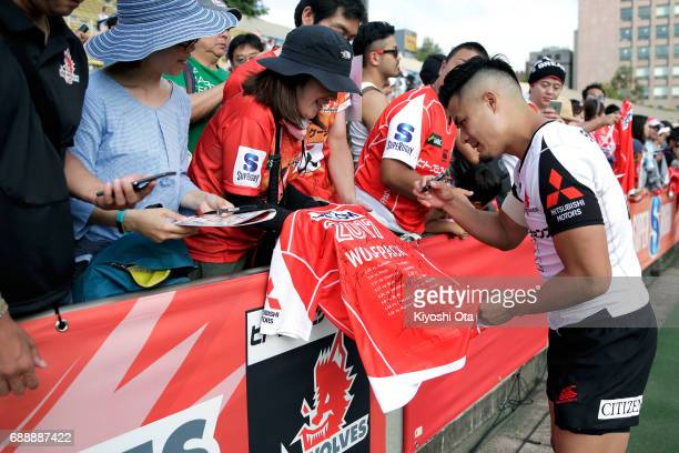 Yu Tamura of the Sunwolves signs autographs for fans after the Super Rugby Rd 14 match between Sunwolves and Cheetahs at Prince Chichibu Memorial...
