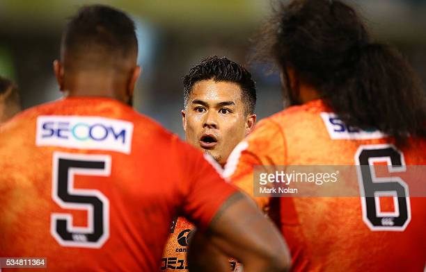 Yu Tamura of the Sunwolves talks to his team mates after a Brumbies try during the round 14 Super Rugby match between the Brumbies and the Sunwolves...