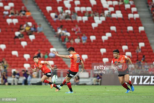 Yu Tamura plays the first ball during the round three Super Rugby match between the Japan Sunwolves and the Cheetahs at Singapore National Stadium on...
