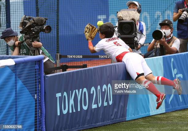 Yu Yamamoto of Team Japan tries to catch a foul ball in the sixth inning of the game against Team United States during softball opening round on day...