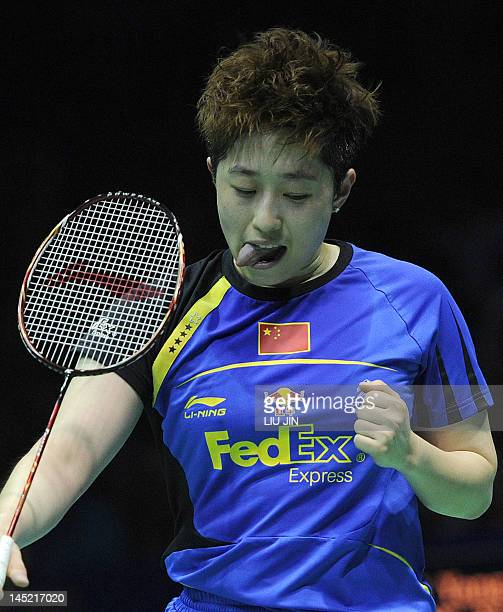 Yu Yang of China reacts to a winning point against Duanganong Aroonkesorn and Kunchala Voravichitchaikul of Thailand during the semifinal match at...
