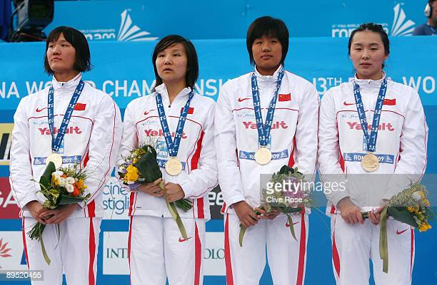 Yu Yang Qian Zhu Jing Liu and Jiaying Pang of China receive the gold medal during the medal ceremony for the Women's 4x 200m Freestyle Final during...
