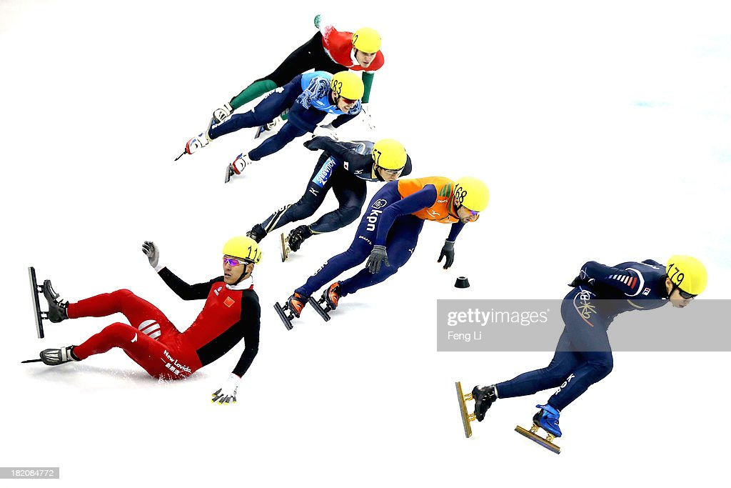 Yu Yongjun of China crashes out as (Right-Left) Lee Han-Bin of Korea, Niels Kerstholt of Netherlands, Yuzo Takamido of Japan, Ruslan Zakharov of Russia and Viktor Knoch of Hungray competing in the Men's 1500m Quarter Final during day three of the Samsung ISU World Cup Short Track at the Oriental Sports Center on September 28, 2013 in Shanghai, China.