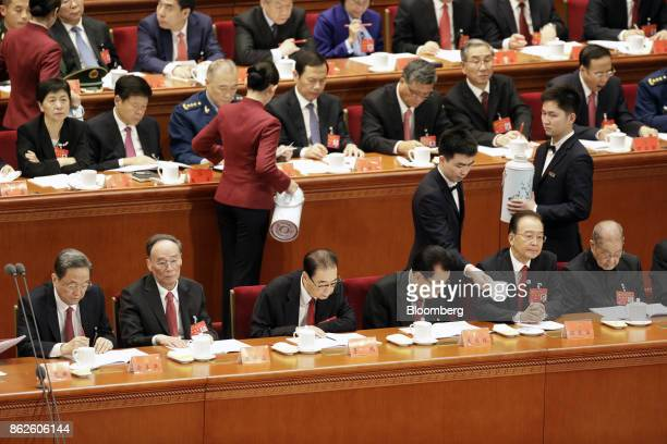 Yu Zhengsheng chairman of the Chinese People's Political Consultative Conference front row from left Wang Qishan secretary of the Central Commission...