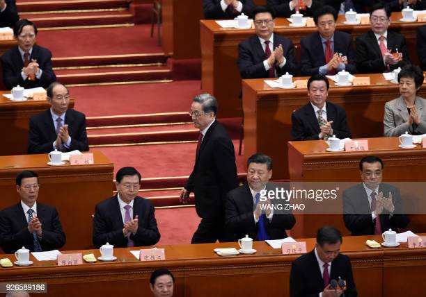 Yu Zhengsheng Chairman of the National Committee of the Chinese People's Political Consultative Conference walks past China's President Xi Jinping as...