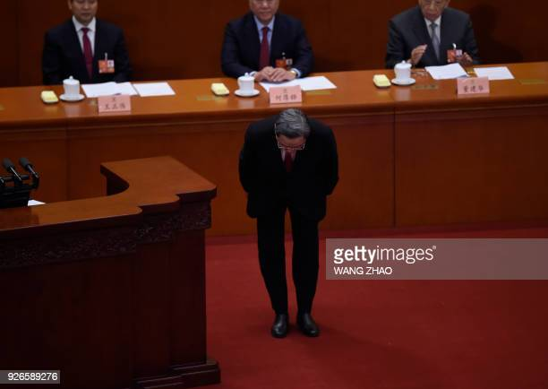 Yu Zhengsheng Chairman of the National Committee of the Chinese People's Political Consultative Conference bows to delegates during the opening...