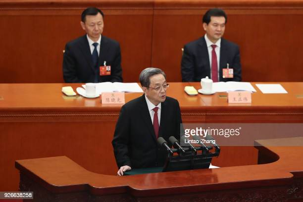 Yu Zhengsheng chairman of the National Committee of the Chinese People's Political Consultative Conference delivers his report during the opening...