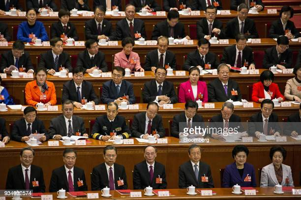 Yu Zhengsheng former chairman of the Chinese People's Political Consultative Conference front row from left Wang Yang chairman of the Chinese...