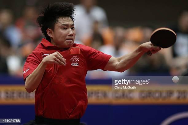 Yu Ziyang of China returns a shot against Jun Mizutani of Japan during the Men's Singles Final on day three of 2014 ITTF World Tour Japan Open at...