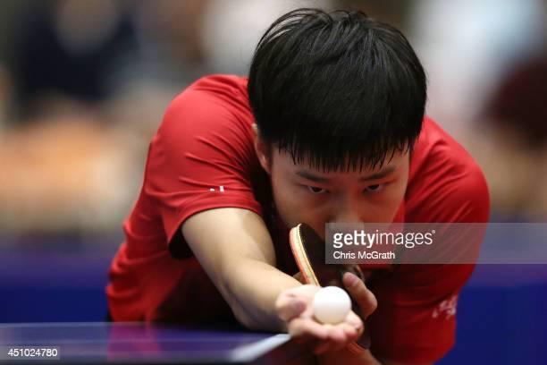 Yu Ziyang of China serves against Jun Mizutani of Japan during the Men's Singles Final on day three of 2014 ITTF World Tour Japan Open at Yokohama...