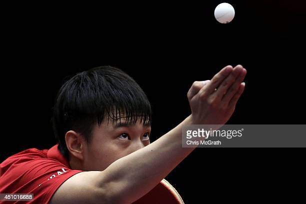 Yu Ziyang of China serves against Tang Peng of Hong Kong during their Men's Singles Semi final match on day three of 2014 ITTF World Tour Japan Open...