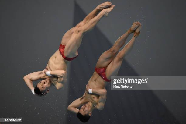 Yuan Cao and Aisen Chen of China compete during the Men's 10m Platform Synchro Final on day one of the FINA Diving World Cup Sagamihara at Sagamihara...