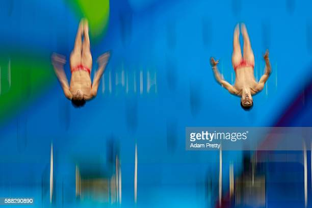 Yuan Cao and Kai Qin of China compete in the Men's Diving Synchronised 3m Springboard Final on Day 5 of the Rio 2016 Olympic Games at Maria Lenk...