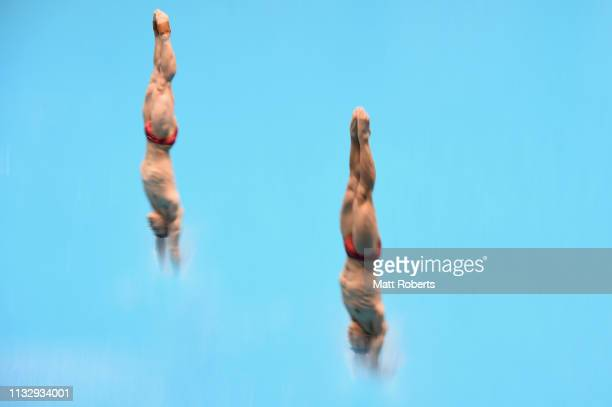Yuan Cao and Siyi Xie of China compete during the Men's 3m Synchro Springboard Final on day one of the FINA Diving World Cup Sagamihara at Sagamihara...