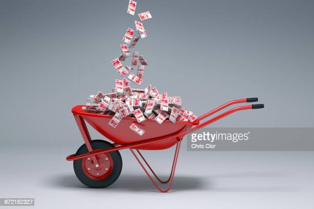 Yuan cash falling into red wheelbarrow