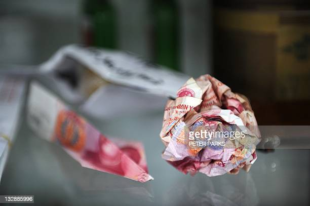 Yuan notes which were thrown over the wall of Chinese artist Ai Weiwei's home are displayed at his studio in Beijing on November 9 2011 Thousands of...