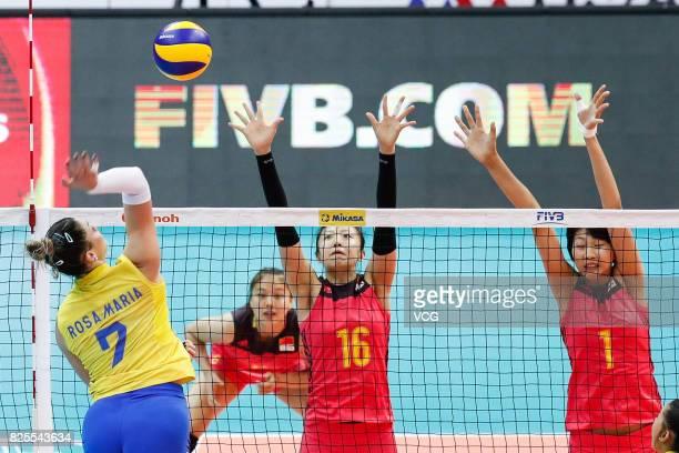 Yuan Xinyue of China and Ding Xia of China block the ball during the group match of 2017 Nanjing FIVB World Grand Prix Finals between China and...