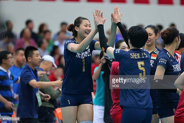Yuan Xinyue of China and Shen Jingsi of China clap hands during Women's Volleyball match between China and India on day two of the 18th Asian Sr...