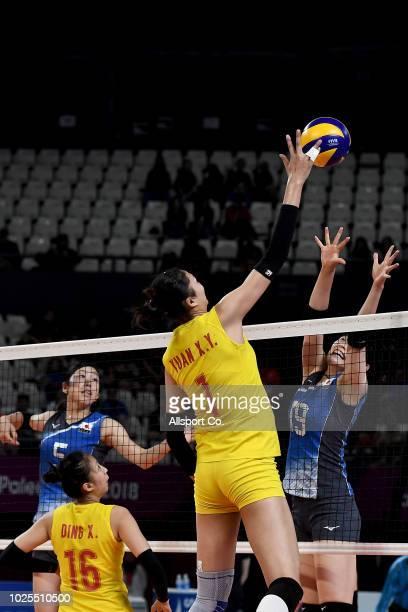 Yuan Xinyue#1 of China spikes at Kurogo Ai of Japan during the Women's Volleyball Semi Final Between China and Japan at the Gelora Bung Karno...