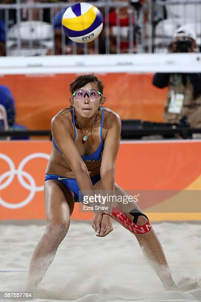 Yuan Yue of China bumps the ball during the Women's Beach Volleyball preliminary round Pool C match against Kerri Walsh Jennings and April Ross of...