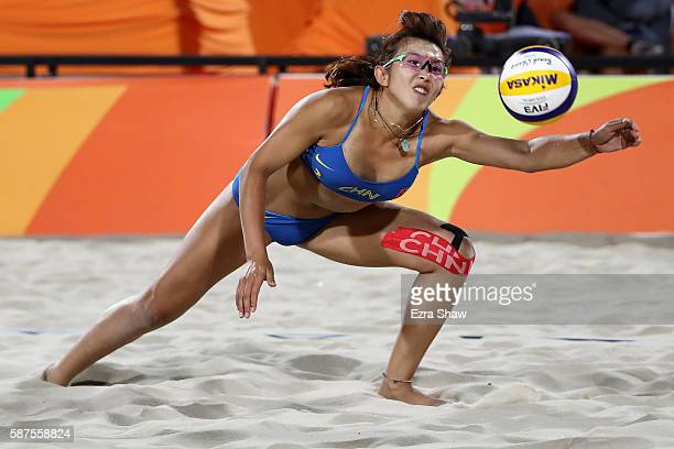 Yuan Yue of China dives for the ball during the Women's Beach Volleyball preliminary round Pool C match against Kerri Walsh Jennings and April Ross...