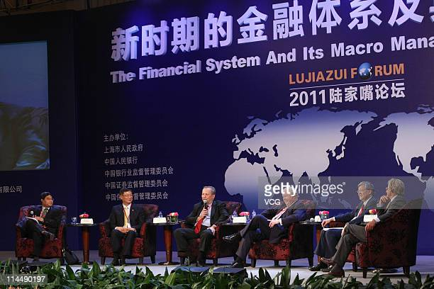 Yuan Zhigang dean of School of Economics of Fudan University Li Lihui vice chairman and president of Bank of China Ltd Lawrence Summers former US...