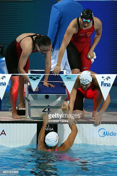 Yuanhui Fu, Jinglin Shi and Ying Lu celebrate with Duo Shen of China after winning the gold medal in the Women's 4x100m Medley Relay Final on day...