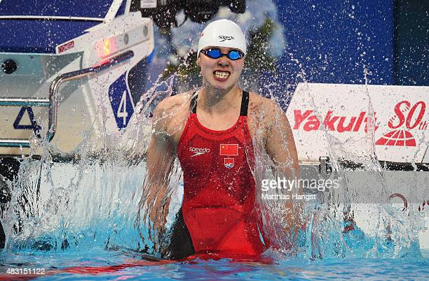 Yuanhui Fu of China celebrates after winning the gold medal in the Women's 50m Backstroke Final on day thirteen of the 16th FINA World Championships...
