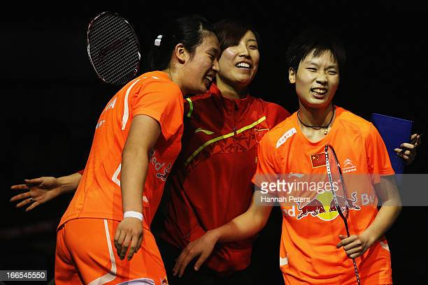 Yuanting Tang and Dongni Ou of China celebrate with their coach after winning the New Zealand Badminton Open Women's Doubles final match between Hoo...