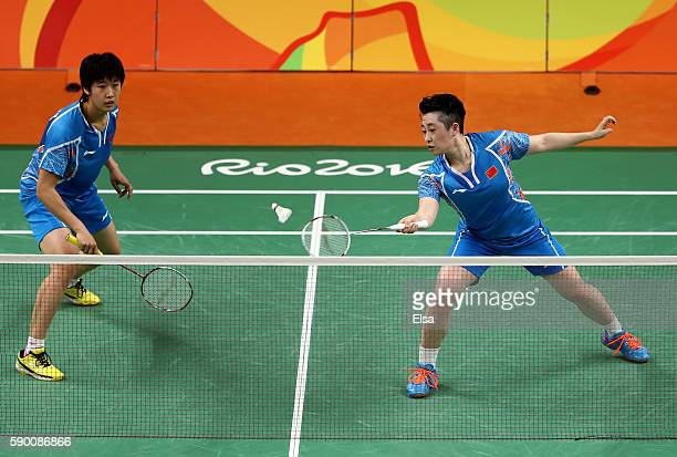 Yuanting Tang and Yang Yu of China return a shot to Christinna Pedersen and Kamilla Juhl Rytter of Denmark during the Women's Doubles Semifinal on...