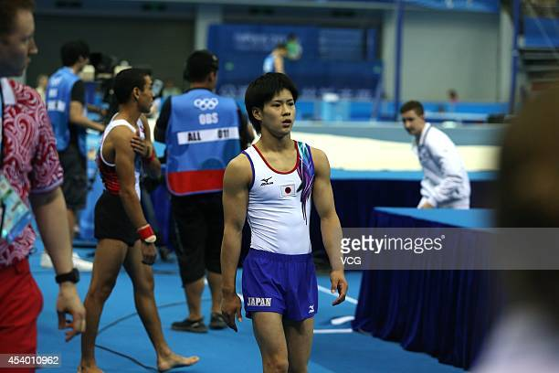 Yuasa Kenya of Japan reacts in the Men's Floor Exercise Final at Nanjing OSC Gymnasium during day seven of the Nanjing 2014 Summer Youth Olympic...
