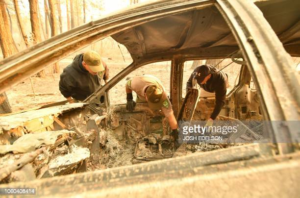 Yuba and Butte County Sheriff officers discover bone fragments inside a burned vehicle in Concow California on November 11 2018 after the Camp fire...