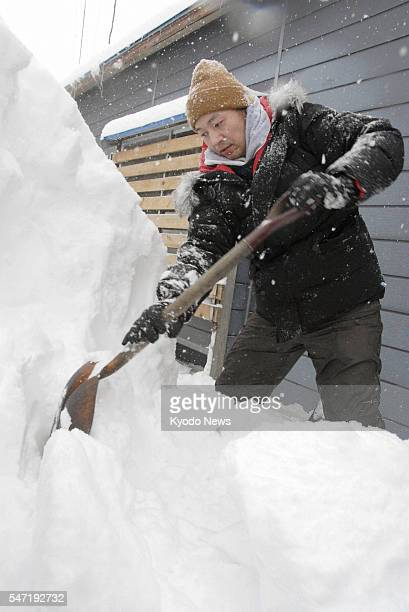 Yubari Japan Creator of adult cartoons Reiji Urashima removes snow from the home of an elderly resident in Yubari Hokkaido in northern Japan on Jan...