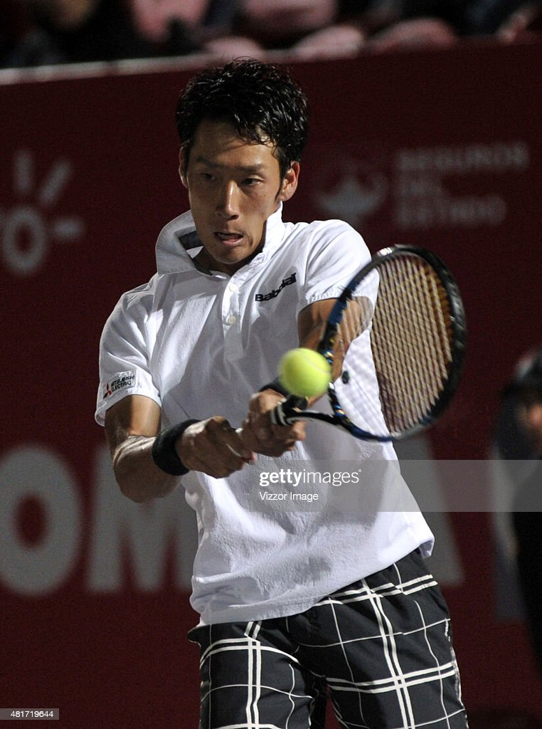 Yuchi Sugita of Japan takes a backhand shot during a match between Yuchi Sugita of Japan and Victor Estrella of Dominican Republic as part of Claro Open Colombia 2015 at Centro de Alto Rendimiento on July 23, 2015 in Bogota, Colombia.