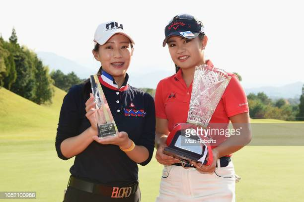 YuChiang Hou of Taiwan and Yui Kawamoto of Japan pose during the trophy presentation of the Udonken Ladies at Mannou Hills Country Club on October 14...