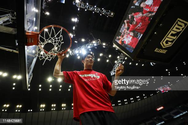 Yudai Baba of Alvark Tokyo cuts down the net to celebrate the victory after the B.League final between Chiba Jets and Alvark Tokyo at Yokohama Arena...