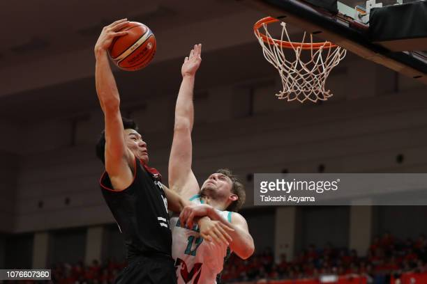 Yudai Baba of Japan shoots while under pressure from Alexandr Zhigulin of Kazakhstan during the FIBA World Cup Asian Qualifier Group F match between...