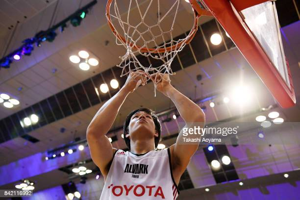 Yudai Baba of the Alvark Tokyo cuts down the net after defeating the Chiba Jets 77-73 in the B.League Kanto Early Cup final between Alvark Tokyo and...