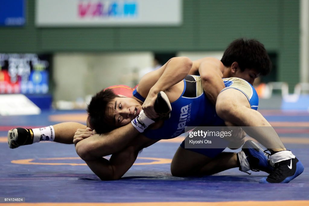 Yudai Fujita (front) competes against Kazuya Koyanagi in the Men's Freestyle 61kg semifinal match on day one of the All Japan Wrestling Invitational Championships at Komazawa Gymnasium on June 14, 2018 in Tokyo, Japan.
