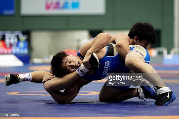 Yudai Fujita competes against Kazuya Koyanagi in the Men's Freestyle 61kg semifinal match on day one of the All Japan Wrestling Invitational...