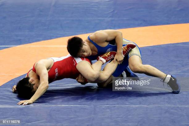 Yudai Fujita competes against Ken Kikuchi in the Men's Freestyle 61kg second round match on day one of the All Japan Wrestling Invitational...