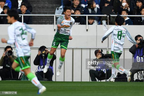 Yudai Fujiwara of Aomori Yamada celebrates scoring his side's first goal during the 98th All Japan High School Soccer Tournament final match between...