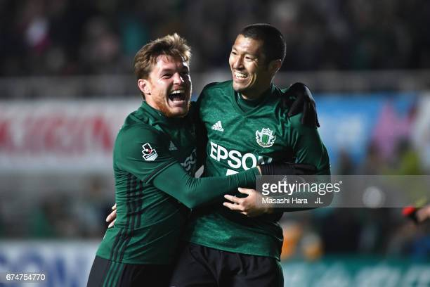 Yudai Iwama of Matsumoto Yamaga celebrates scoring his side's fourth goal with his team mate Paulinho during the JLeague J2 match between Matsumoto...