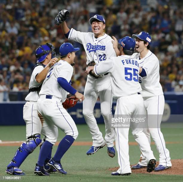 Yudai Ono celebrates with teammates after pitching no-hitter in Chunichi Dragons' 3-0 win over Hanshin Tigers in Nagoya, central Japan, on Sept. 14,...