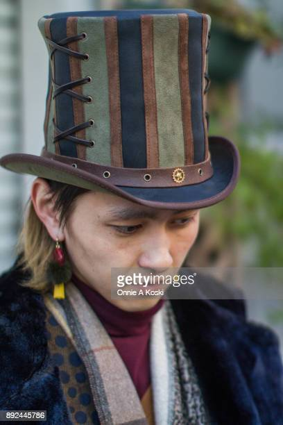 Yudai Takanashi wearing a Steampunk Hater Absinthe top hat a fur lined herringbone overcoat a leopard print shirt black harem pants and brown leather...