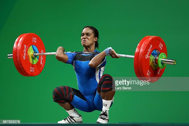 Yuderquis Maridalia Contreras of the Dominican Republic competes during the Women's 58kg Group A weightlifting contest on Day 3 of the Rio 2016...